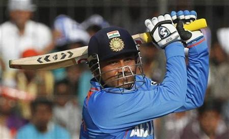 India's captain Virender Sehwag plays a shot during their fourth one-day international cricket match against West Indies in Indore December 8, 2011. REUTERS/Amit Dave