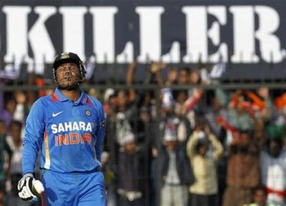 India's captain Virender Sehwag celebrates scoring his century during their fourth one-day international cricket match against the West Indies in Indore December 8, 2011. REUTERS/Amit Dave