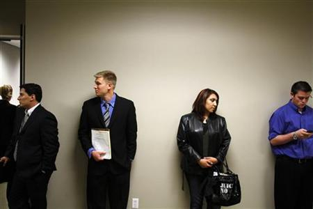 People wait to be interviewed during the Chase Bank Veterans Day job fair in Phoenix, November 11, 2011.  REUTERS/Joshua Lott