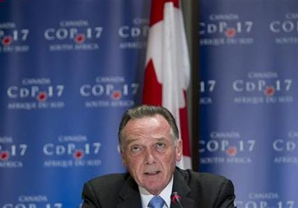 Canada's Environment Minister Peter Kent addresses the media at the United Nations Climate Change Conference (COP17) in Durban December 6, 2011. The city is hosting the conference which runs until December 9. REUTERS/Rogan Ward