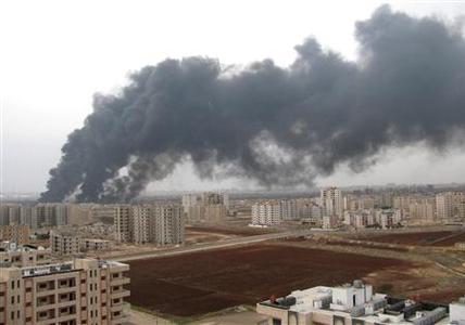 Black smoke is seen from Homs refinery, December 8, 2011. REUTERS-SANA-Handout