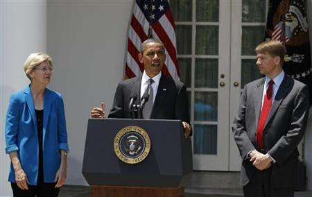 President Obama announces that Richard Cordray (R) is his choice to serve as the first Director of the Consumer Financial Protection Bureau, in the Rose Garden of the White House, July 18, 2011. At left is  Elizabeth Warren.              REUTERS/Larry Downing