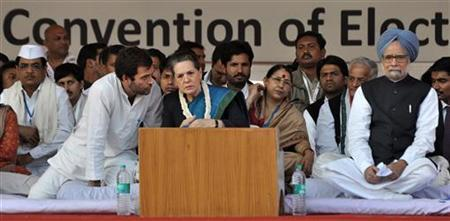 Chief of Congress party Sonia Gandhi (C) listens to her son Rahul Gandhi, as Prime Minister Manmohan Singh looks on at a rally of the Youth Congress in New Delhi November 29, 2011. REUTERS/Stringer/Files