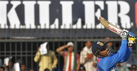 Virender Sehwag plays a shot during their fourth one-day international cricket match against West Indies in Indore December 8, 2011. REUTERS/Amit Dave