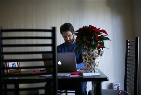 Karel Baloun works on his computer at his home in Lafayette, California, December 2, 2011. REUTERS/Robert Galbraith