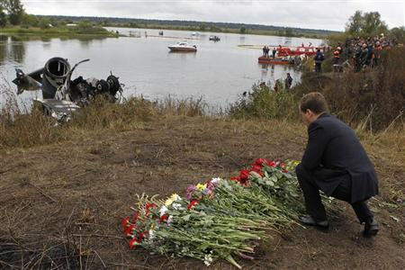 Russia's President Dmitry Medvedev places flowers at the site of a plane crash near the Russian city of Yaroslavl September 8, 2011. REUTERS/Dmitry Astakhov/RIA Novosti/Kremlin