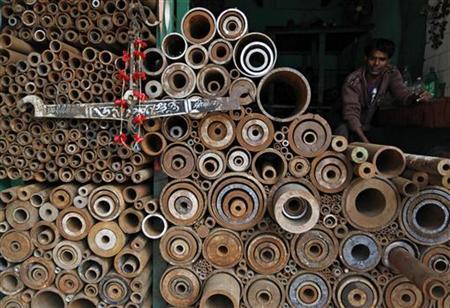 A worker sits inside a shop at a wholesale iron market in Kolkata December 13, 2010. REUTERS/Rupak De Chowdhuri/Files