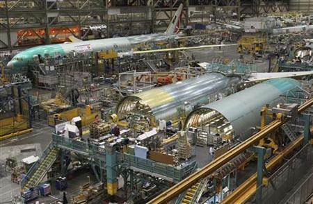 A Boeing 777 jetliner being manufactured for customer Turkish Airlines is seen in the background, near the fuselage of two other 777s (front), on the production line at Boeing's Commercial Airplane manufacturing facility in Everett, Washington, February 14, 2011. REUTERS/Anthony Bolante