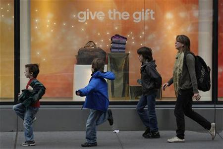 Children run past a storefront decorated for the holidays in New York, November 22, 2011. REUTERS/Jessica Rinaldi