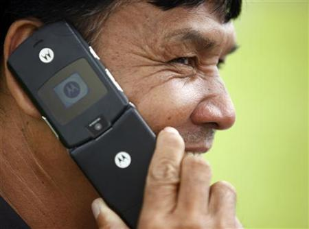 A man uses his Motorola mobile phone in Bangkok August 16, 2011. REUTERS/Chaiwat Subprasom/Files