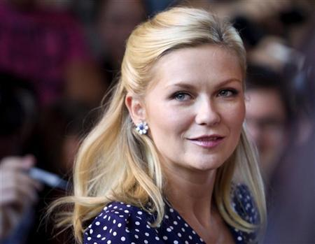 Actor Kirsten Dunst arrives at the gala premier of the movie Melancholia outside the Ryerson Theatre, at the 36th Toronto International Film Festival in Toronto September 10, 2011.  REUTERS/Fred Thornhill