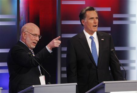 Former Massachusetts Governor Mitt Romney (R) gets some direction from a member of the stage crew before the Republican Party presidential candidates debate at Drake University in Des Moines, Iowa, December 10, 2011.    REUTERS/Jeff Haynes