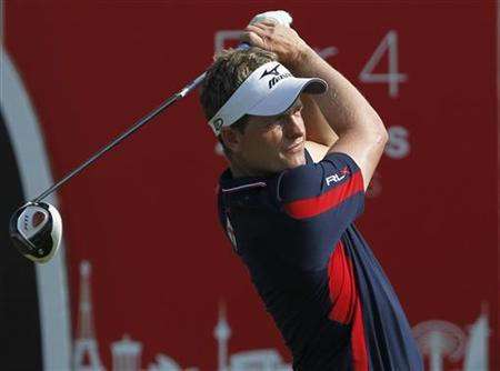 Luke Donald of England watches his shot from the 10th tee during the final round of the Dubai World Championship at the Jumeirah Golf Estates in Dubai December 11, 2011. REUTERS/Jumana El Heloueh