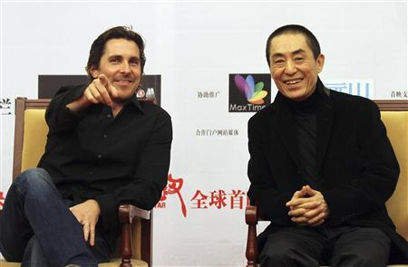 British actor Christian Bale (L) and Chinese director Zhang Yimou attend the premiere of ''The Flowers of War'' in Beijing December 11, 2011.  REUTERS/China Daily
