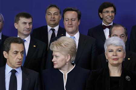 EU leaders pose for a family photo after Croatia signed an accession treaty with the European Union, at a summit in Brussels December 9, 2011.      REUTERS/Thierry Roge