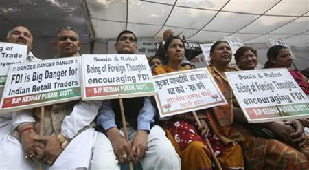 Activists from Bharatiya Janata Party (BJP) hold placards while taking part in a protest against government's decision to allow Foreign Direct Investment (FDI) in the retail sector, in New Delhi November 28, 2011. REUTERS/Parivartan Sharma/Files