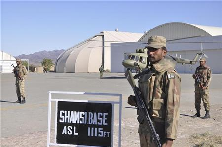 Pakistan Army soldiers are seen standing guard at the Shamsi airfield in Baluchistan province in this ISPR (Inter Services Public Relations) handout image December 11, 2011.  REUTERS/ISPR/Handout