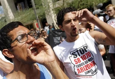 Demonstrators yell at police officers during a protest against Arizona's controversial Senate Bill 1070 immigration law outside Sheriff Joe Arpaio's office in Phoenix July 29, 2010.  REUTERS/Joshua Lott