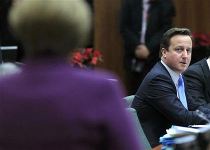 Britain's Prime Minister David Cameron (R) looks at Germany's Chancellor Angela Merkel (L) at a European Union summit in Brussels December 9, 2011.       REUTERS/Yves Herman