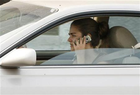 A woman talks on her cell phone while driving in Burbank, California June 25, 2008. REUTERS/Fred Prouser