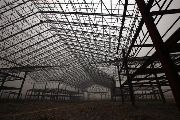 The steel frame of an abandoned building stands in what would have been an amusement park called 'Wonderland', on the outskirts of Beijing December 5, 2011.  REUTERS-David Gray