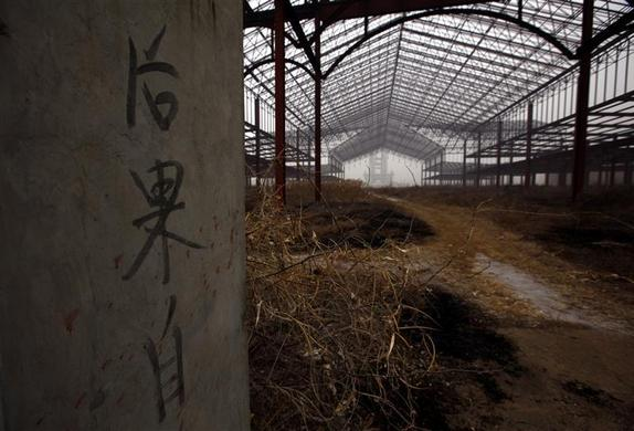 Writing on a gate tells people to 'be responsible for your actions' when entering an abandoned building that was to be part of an amusement park called 'Wonderland', on the outskirts of Beijing December 5, 2011.   REUTERS-David Gray