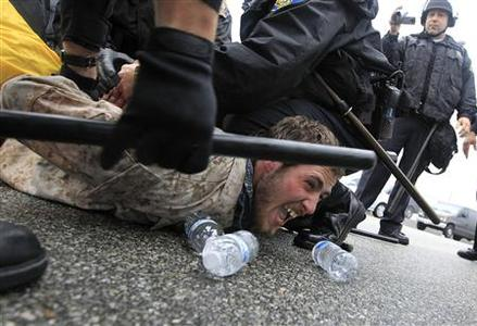 Police arrest a protester during the Occupy movements' attempt to shut down west coast ports in Long Beach, California December 12, 2011. REUTERS/Lucy Nicholson