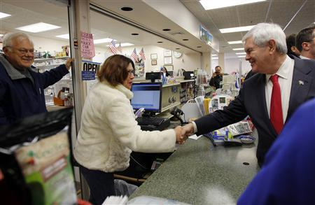 Republican presidential candidate and former Speaker of the House of Representatives Newt Gingrich (R) greets voters at Hollis Pharmacy in Hollis, New Hampshire December 12, 2011.   REUTERS/Brian Snyder