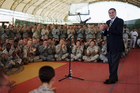 Defense Secretary Leon Panetta (R) speaks to military personnel during his visit to Camp Lemonnier in Djibouti, December 13, 2011. REUTERS/Pablo Martinez Monsivais/Pool