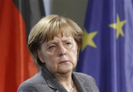 German Chancellor Angela Merkel looks on as she addresses a news conference following talks with Michael Sommer (not pictured), head of Germany's labour union association DGB, in Berlin, December 13, 2011. REUTERS/Fabrizio Bensch