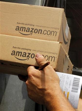 A driver delivers two packages from Amazon.com in Boston, Massachusetts July 26, 2011.    REUTERS/Brian Snyder