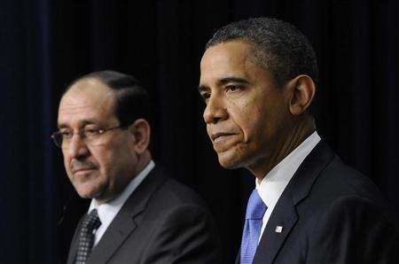 Iraq's Prime Minister Nuri al-Maliki (L) and President Barack Obama (R) listen to questions during a joint news conference in the Eisenhower Executive Office Building on the White House campus in Washington, December 12, 2011. REUTERS Jonathan Ernst
