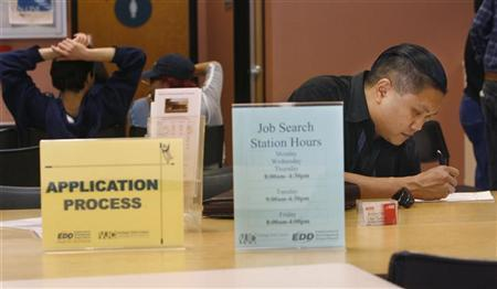 Joseph Sulleven fills out a registration form as he begins his search for a job at the Verdugo Jobs Center, a partnership with the California Employment Development Department, in Glendale, California November 7, 2008.  REUTERS/Fred Prouser