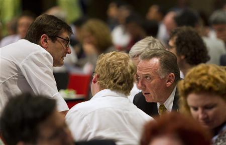 Australia's Minister for Climate Change Greg Combet (L) speaks with Canada's Environment Minister Peter Kent during a break in plenary session at the United Nations Climate Change Conference (COP17) in Durban December 10, 2011. REUTERS/Rogan Ward