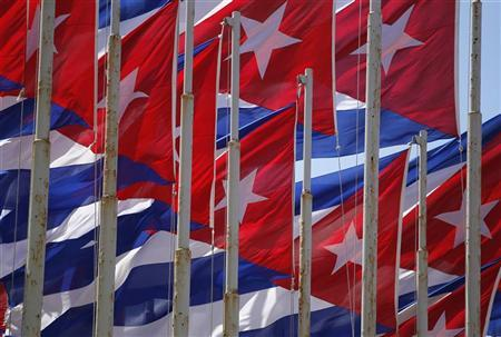 Cuban flags fly beside the Interests Section Office of the United States (USINT), in Havana July 28, 2010, two days after the 57th anniversary of the start of the Cuban revolution.   REUTERS/Desmond Boylan