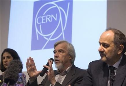 Rolf Heuer (C), CERN Director General, gestures next to Fabiola Gianotti (L), ATLAS experiment spokesperson, and Guido Tonelli, CMS experiment spokesperson, during a news conference at the CERN (European Organisation for Nuclear Research) in Meyrin, near Geneva December 13, 2011.  REUTERS/Denis Balibouse