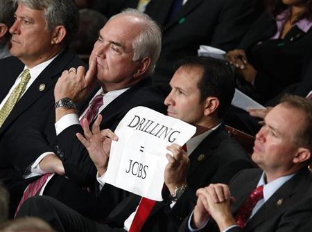 U.S. Rep. Jeff Landry (R-LA) holds a sign during U.S. President Barack Obama's address before a joint session of Congress inside the chamber of the House of Representatives on Capitol Hill in Washington September 8, 2011. REUTERS/Larry Downing