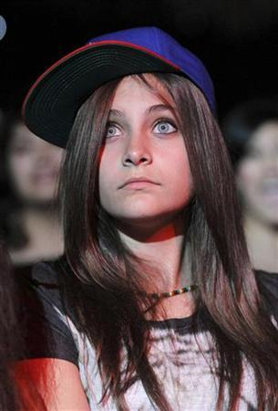 Paris Michael Katherine Jackson, the daughter of late singer Michael Jackson, watches from the front row as R&B artist Chris Brown performs in concert during the F.A.M.E. Tour in Los Angeles October 20, 2011. REUTERS/Danny Moloshok