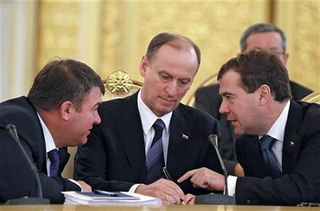Russia's President Dmitry Medvedev (R), Security Council chief Nikolai Patrushev (C) and Defense Minister Anatoly Serdyukov attend a meeting of the Commonwealth of Independent States (CIS) leaders in Moscow's Kremlin, December 10, 2010.  REUTERS/Dmitry Astakhov/RIA Novosti/Kremlin