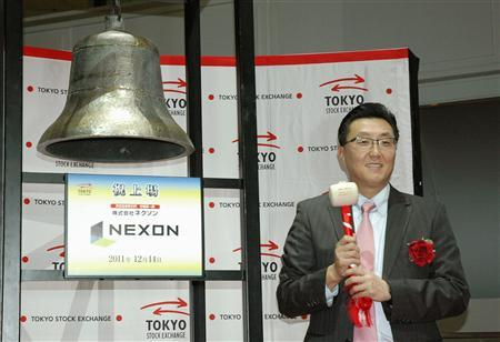 Nexon Co. President Choi Seung-woo poses prior to ringing a bell during a ceremony to mark the company's debut on the Tokyo Stock Exchange in Tokyo, in this photo taken by Kyodo on December 14, 2011. REUTERS/Kyodo