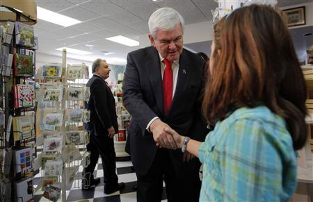 Newt Gingrich greets a young girl during a campaign stop at Hollis Pharmacy in Hollis, New Hampshire, December 12, 2011.   REUTERS/Brian Snyder