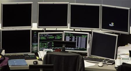 Screens are blank at a workplace at the Frankfurt stock exchange September 30, 2008.  REUTERS/Alex Grimm (GERMANY)
