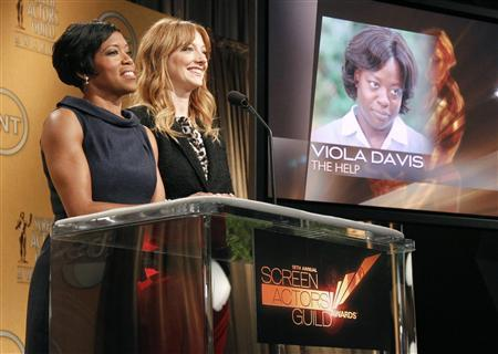 Actresses Regina King (L) and Judy Greer announce Viola Davis as outstanding performance by a female actor in a leading role nominee for her work in ''The Help'' for 18th Annual Screen Actors Guild Awards in West Hollywood, December 14, 2011. ''The Help'' received four total nominations.  REUTERS/Danny Moloshok