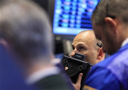 Traders work on the floor of the New York Stock Exchange December 13, 2011.     REUTERS/Brendan McDermid