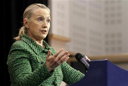 Secretary of State Hillary Clinton holds a news conference after a NATO foreign ministers meeting at the Alliance headquarters in Brussels December 8, 2011. REUTERS/Sebastien Pirlet
