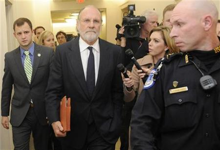 Former MF Global CEO Jon Corzine (2nd L) is trailed by reporters after testifying about the firm's bankruptcy during a hearing before the U.S. House Agriculture Committee on Capitol Hill in Washington, December 8, 2011. REUTERS/Jonathan Ernst