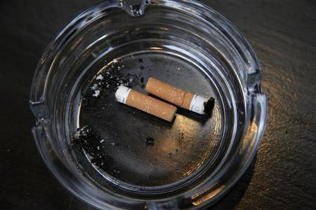 An ashtray with cigarette butts is seen outside a restaurant, in London March 9, 2011.  REUTERS/Stefan Wermuth