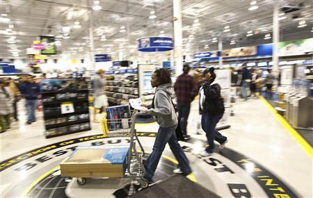 A women pushes her shopping cart at a Best Buy store in Pineville, North Carolina November 25, 2011. REUTERS/Chris Keane