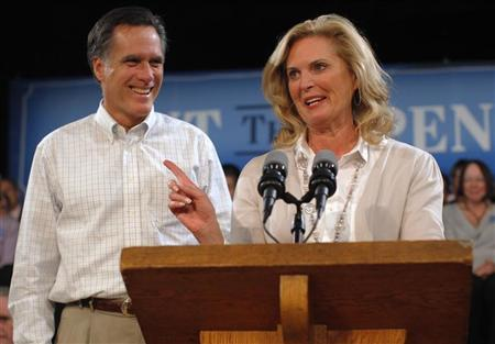Republican presidential candidate and former Massachusetts Governor Mitt Romney (L) is introduced by his wife, Ann Romney, for a speech about his fiscal policy in Exeter, New Hampshire November 3, 2011. REUTERS/Brian Snyder