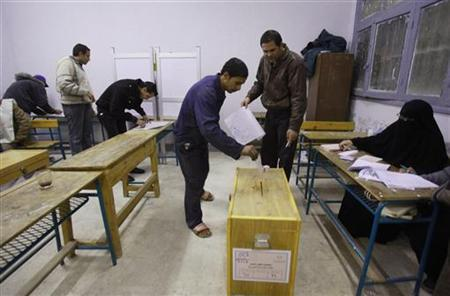 A man casts his vote in a school used as a polling center during the second day of parliamentary elections in Suez December 14, 2011. REUTERS/Asmaa Waguih